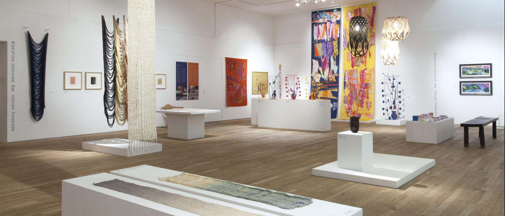 Exhibition of colourful textiles within a white space