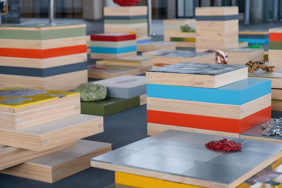 Colourful stacked boxes and objects displayed at Y Senedd