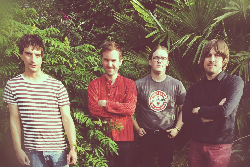 Band members of Worldcub in greenery