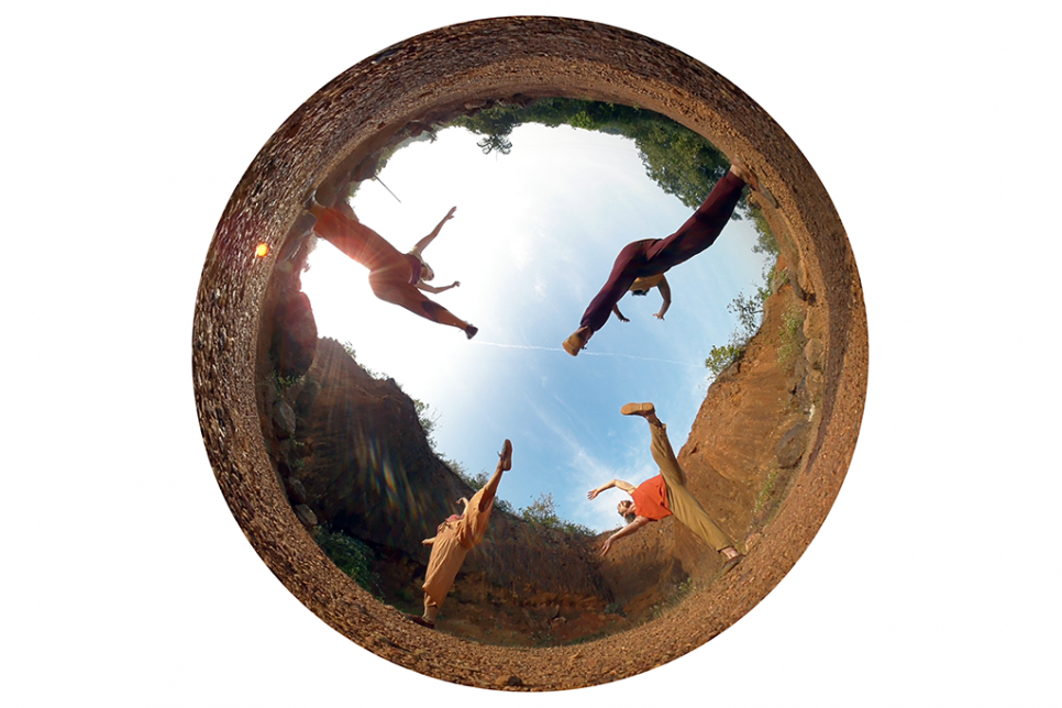 Dome shaped reflection image of four dancers outdoors